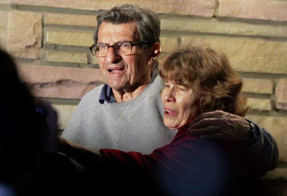 Joe Paterno and  wife Susan  thank well-wishers gathered outside their home last week. Photo: GENE J. PUSKAR, ASSOCIATED PRESS