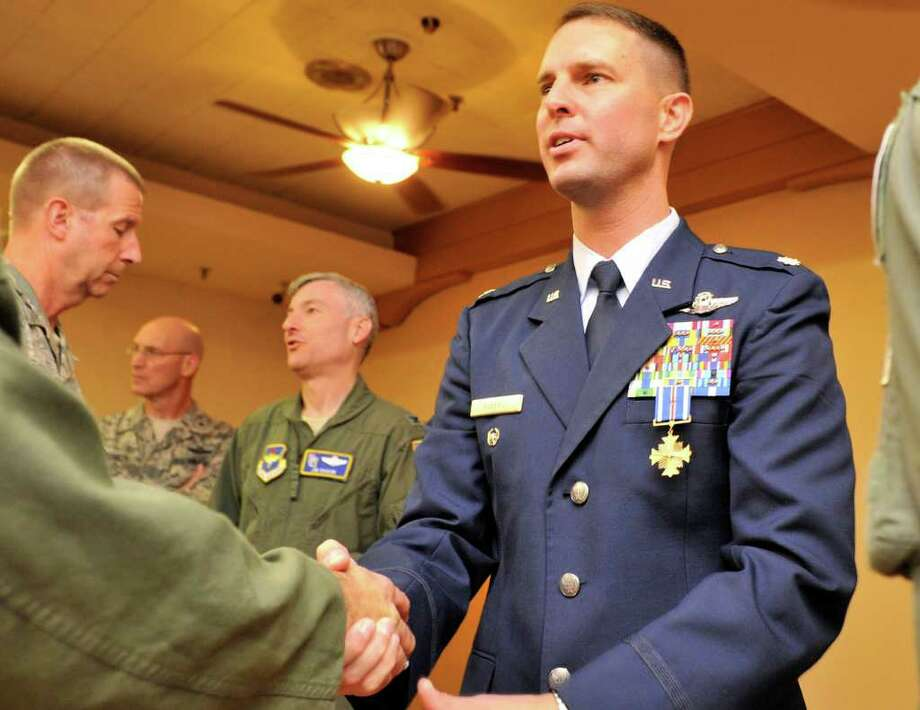 Lt. Col. Gregory Roberts greets well-wishers after receiving the Distinguished Flying Cross with Valor during a Thursday afternoon ceremony at Randolph AFB. Photo: Photo By Robin Jerstad/Special To The Express-News