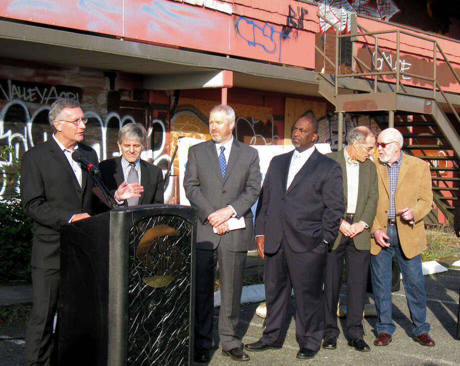 Rick Hooper, Seattle director of the Office of Housing, speaks at a news conference with Seattle Mayor Mike McGinn (third from left) at a news conference at the old Thunderbird Motel on Aurora Avenue on Nov. 10, 2011. Photo courtesy city of Seattle.