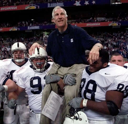 This Dec. 28, 1999 file photo shows Penn State defensive coordinator Jerry Sandusky being carried by players Rick Bolinsky (92) and Jason Wallace (88) after the Alamo Bowl in San Antonio. Pennsylvania state prosecutors said Sandusky, 67, was arrested Saturday, Nov. 5, 2011, on charges that he sexually abused eight young men. / AP1999
