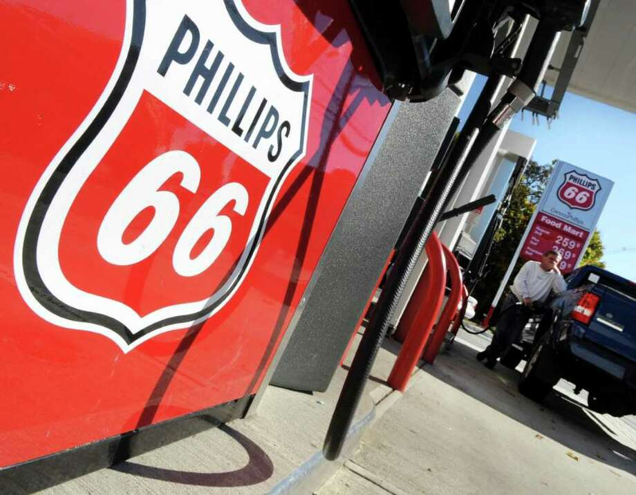 Lisa Poole : AP File HISTORIC SIGN: The Phillips 66 logo, inspired by the iconic Route 66, evokes the signs for U.S. highway routes. Photo: Lisa Poole / AP2009