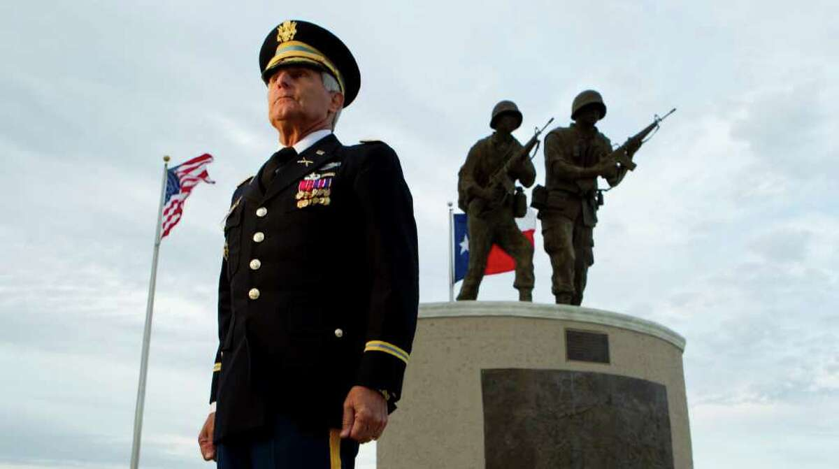 Retired Army Col. Albert Nahas poses for a portrait near the Houston Vietnam War memorial Wednesday, Nov. 9, 2011, in Houston. Nahas, a Vietnam veteran from Sugar Land, spent six years and traveled 35,000 miles to compile photographs and stories about Vietnam memorials in all 50 states. He has published a book documenting the memorials. ( Brett Coomer / Houston Chronicle )