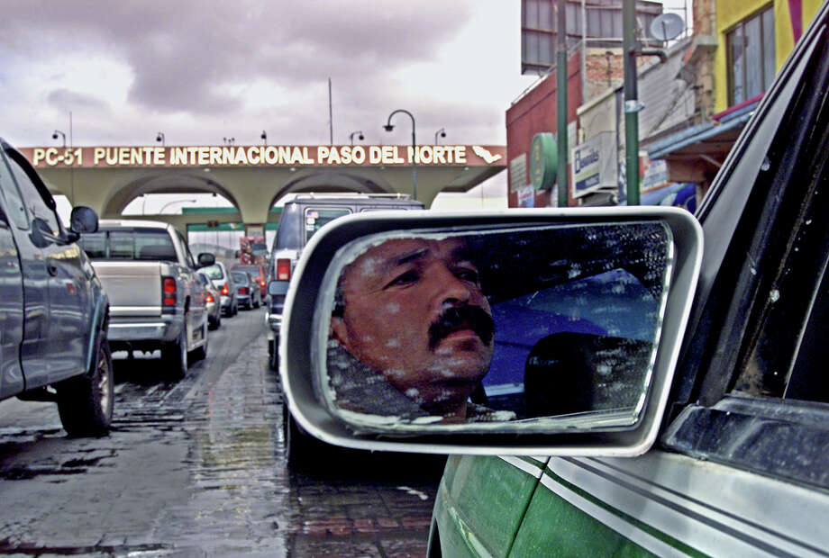 A taxi driver waits in a long line at the Juarez-El Paso bridge in 2004. A new pilot program intends to streamline the wait. Photo: Associated Press, Guillermo Arias