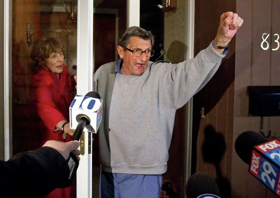 "Penn State coach Joe Paterno and his wife Sue on the front porch of their house, address students. The students yelled ""We Are Penn State"" and Paterno responded, ""Yes we are!"" Photo: JOE HERMITT, Associated Press / THE PATRIOT-NEWS"