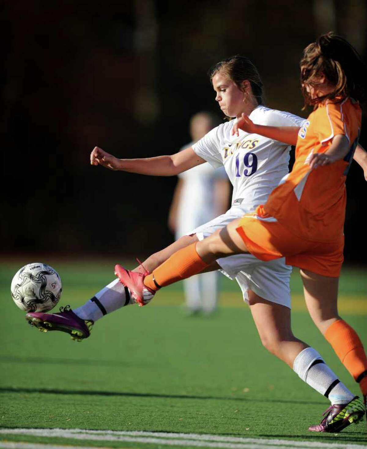 Westhill's Jess Laszlo controls the ball as Danbury's Elizabeth Howe defends during the first round class LL state playoff soccer match Thursday, Nov. 10, 2011 at the Westhill campus.