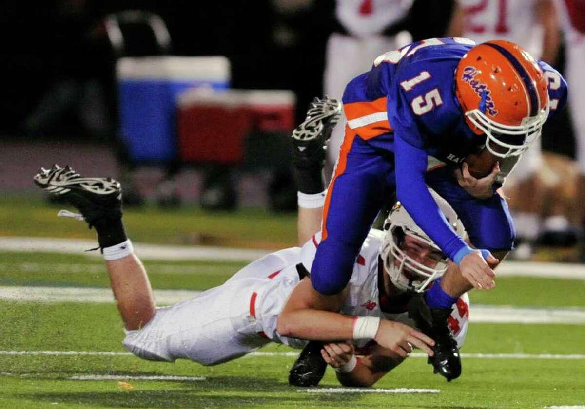 Greenwich's Patrick Callahan brings down Danbury quarterback Garin Mooney during their game at Danbury High School on Thursday, Nov. 10, 2011.