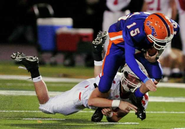 Greenwich's Patrick Callahan brings down Danbury quarterback Garin Mooney during their game at Danbury High School on Thursday, Nov. 10, 2011. Photo: Jason Rearick / The News-Times