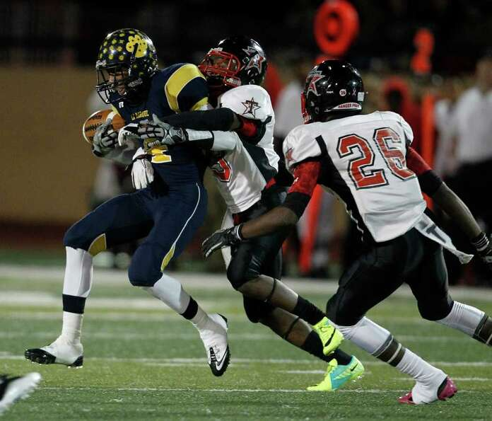 LaMarque's Justin Williams (4) gets the ball knocked loose for the turnover.