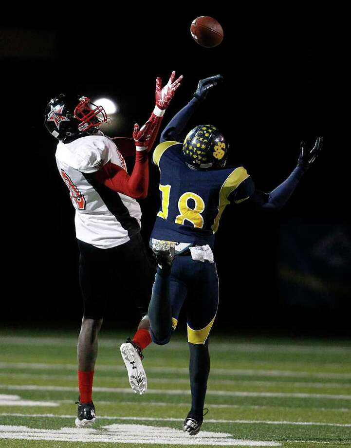 LaMarque's Devon Hayward (18) breaks up a pass intended for Terry's Wilson Tyler (80) during the first half of the high school football game at the Alvin Memorial Stadium, Nov. 10, 2011. Halftime score is LaMarque19-Terry-17. Photo: Karen Warren, Houston Chronicle / © 2011 Houston Chronicle