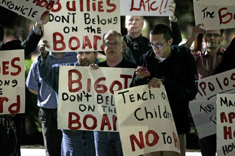 Protesters outside HISD central office criticized Manuel Rodriguez Jr., whose campaign flier called out his opponent's sexuality. The incumbent won by 24 votes. More than a dozen speakers during an HISD board meeting Thursday attacked his campaign and urged him not to be a bully. Photo: Melissa Phillip / © 2011 Houston Chronicle