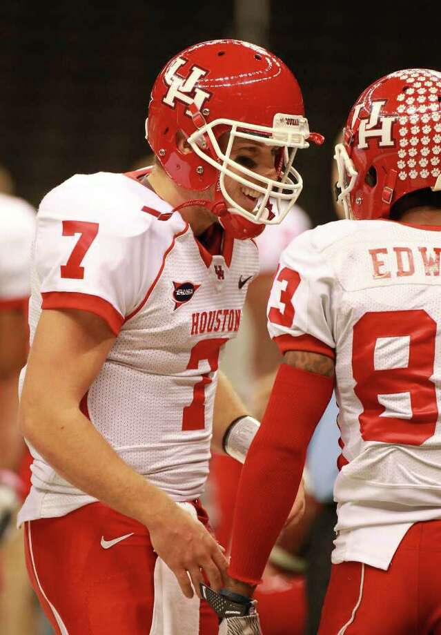 UH quarterback Case Keenum, left, and receiver Patrick Edwards, who are both seniors, celebrate after the two connected for a touchdown. Photo: Nick De La Torre, Houston Chronicle / © 2011  Houston Chronicle