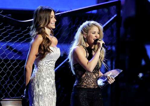 Shakira, right, accepts the person of the year award at the 12th Annual Latin Grammy Awards on Thursday Nov. 10, 2011 in Las Vegas. Looking on is Sofia Vergara. (AP Photo/Julie Jacobson) Photo: Julie Jacobson / AP