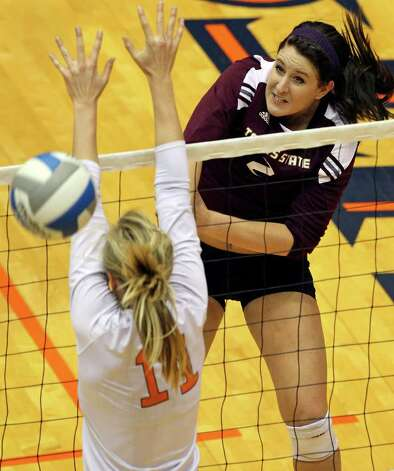 The Bobcat's Lindy DeGeare jams a shot by Kelsey Schwirtich as UTSA volleyball plays Texas State at the UTSA Convocation Center on November 10, 2011.  Tom Reel/Staff Photo: TOM REEL, Express-News / © 2011 San Antonio Express-News