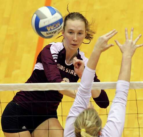 The Bobcat's Ashlee Hilburn slams one down as UTSA volleyball plays Texas State at the UTSA Convocation Center on November 10, 2011.  Tom Reel/Staff Photo: TOM REEL, Express-News / © 2011 San Antonio Express-News