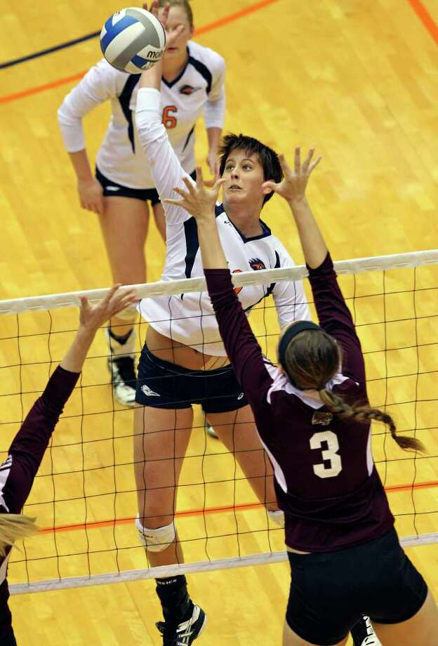 The Roadrunner's McKenzie Adams  slams a shot over Amari Deardorff as UTSA volleyball plays Texas State at the UTSA Convocation Center on November 10, 2011.  Tom Reel/Staff Photo: TOM REEL, Express-News / © 2011 San Antonio Express-News