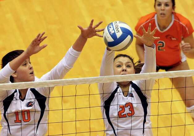 McKenzie Adams (10) and Dempsey Thornton stop a ball at the net as UTSA volleyball plays Texas State at the UTSA Convocation Center on November 10, 2011.  Tom Reel/Staff Photo: TOM REEL, Express-News / © 2011 San Antonio Express-News