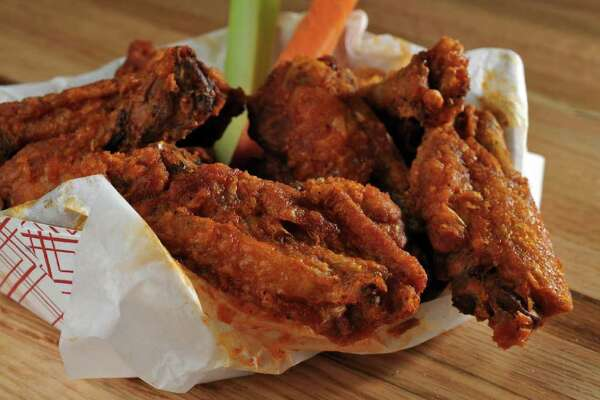 Chicken wings from Scubbers 2, photographed in the Times Union photography studio on Wednesday Nov. 9, 2011 in Colonie, NY.  (Philip Kamrass / Times Union )
