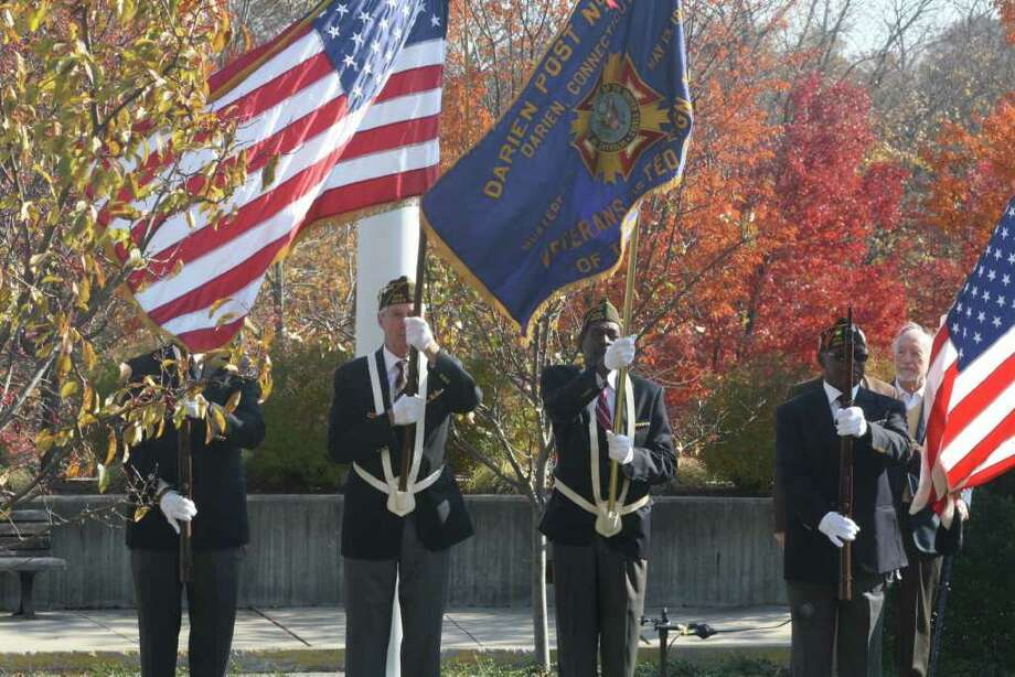 Members of the Darien VFW Color Guard participate in Friday's ceremony at Town Hall. Photo: Ben Holbrook
