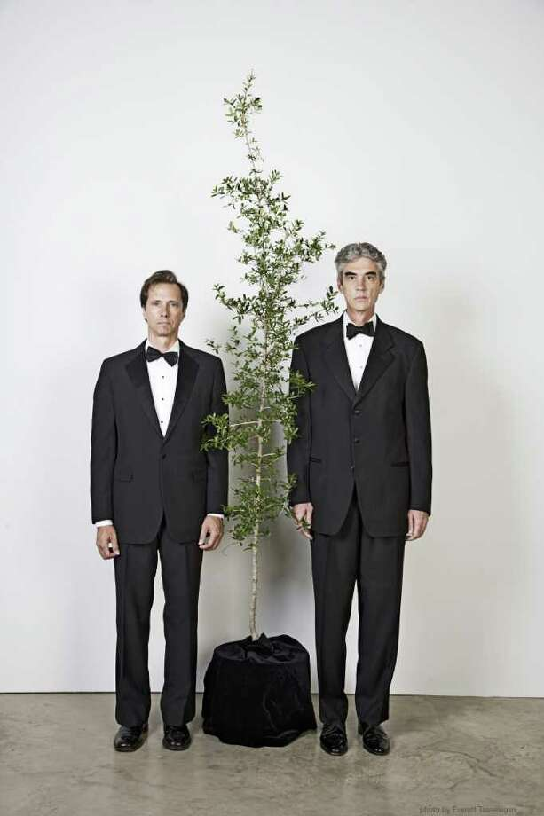 EVERETT TAASEVIGEN the happy couple: The Art Guys - Jack Massing, left, and Michael Galbreth - are staging a performance in which they marry a plant. Photo: Everett Taasevigen / handout
