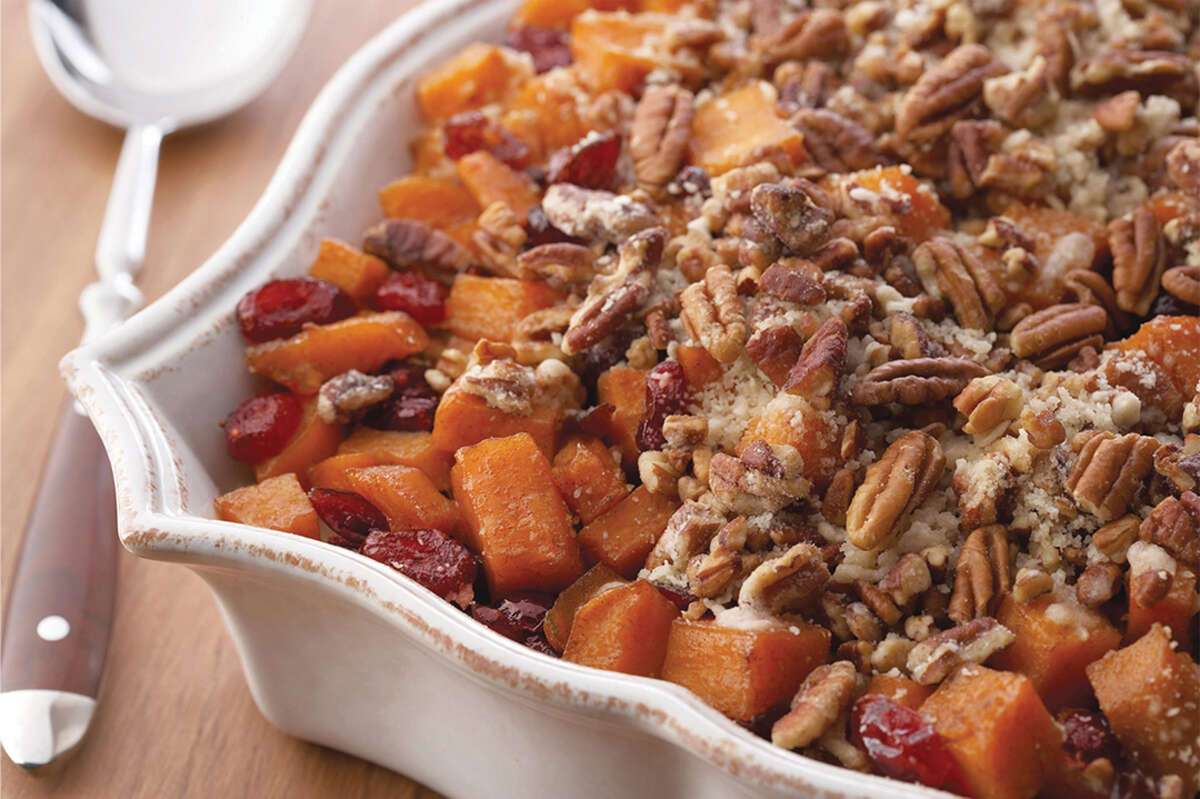 Cranberries and Pecans add flavor to Roasted Sweet Potatoes with Cinnamon Pecan Crunch.