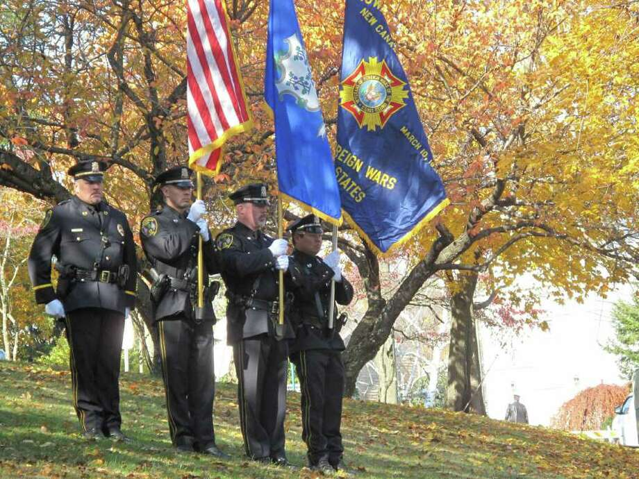 The honor guard stands attention at the beginning of the Veteran's Day ceremony at God's Acre. Photo: Paresh Jha