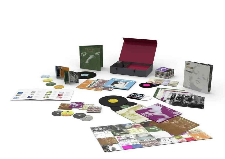 The Smith Complete, by The Smiths Super deluxe box set: 8 albums on vinyl, CD; plus 25 7-inch singles, DVD, poster, booklet, prints - $410