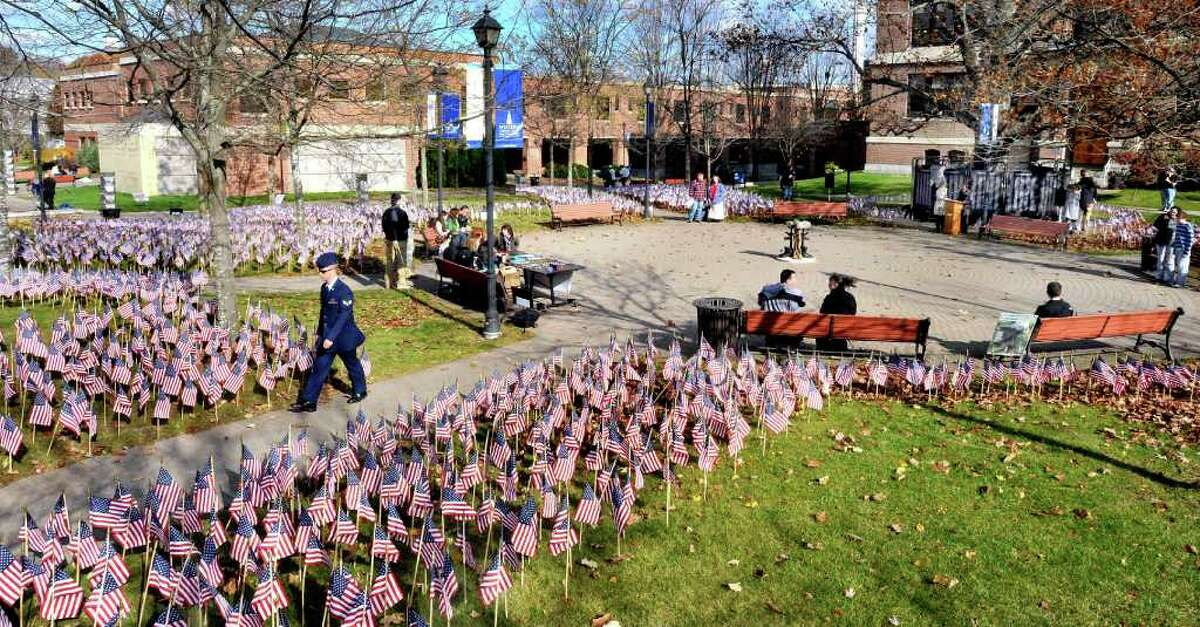 The names of Americans who died fighting in Iraq and Afganistan are read during the Remembrance Day Roll Call at Western Connecticut State University's downtown campus Friday, Nov. 11, 2011.