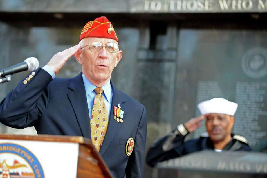 Marine Colonel Thomas Kanasky, of Bridgeport, salutes during the Veterans Day Ceremony Friday, Nov. 11, 2011 at the Col. Mucci Memorial Green located on McLevy Green in Bridgeport, Conn. Photo: Autumn Driscoll / Connecticut Post