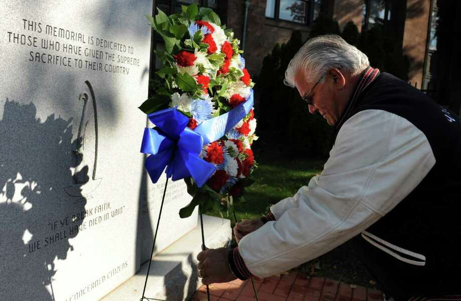 Army and Marine veteran Frank Somohano, of Milford, places a wreath in front of the Vietnam War monument during the Veterans Day Ceremony Friday, Nov. 11, 2011 at the Col. Mucci Memorial Green located on McLevy Green in Bridgeport, Conn. Photo: Autumn Driscoll / Connecticut Post