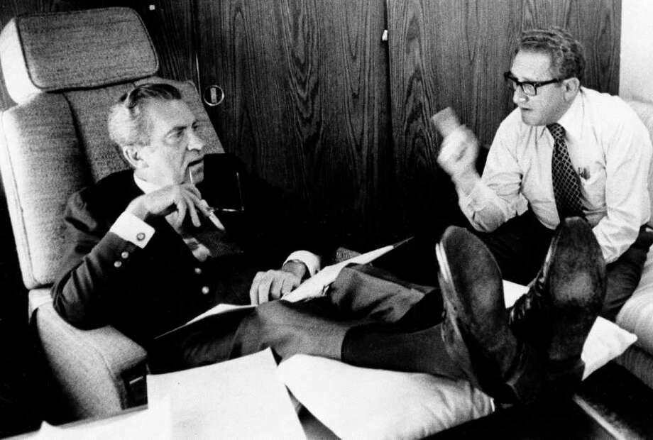 In this June 25, 1974, photo released by the White House, President Richard Nixon listens to his Secretary of State Dr. Henry Kissinger aboard the plane that brought the U.S. president to Belgium. Within two months Nixon had resigned, and in June 1975, the feisty ex-President defended his shredded legacy and shady Watergate-era actions in grand jury testimony that he thought would never come out. Photo: AP