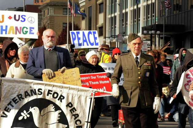 World War II veteran Ed Bloch,right, of Albany walks with Veterans for Peace and Occupy Albany participants in the Veteran's Day Parade in Albany, NY Friday.( Michael P. Farrell/Times Union) Photo: Michael P. Farrell