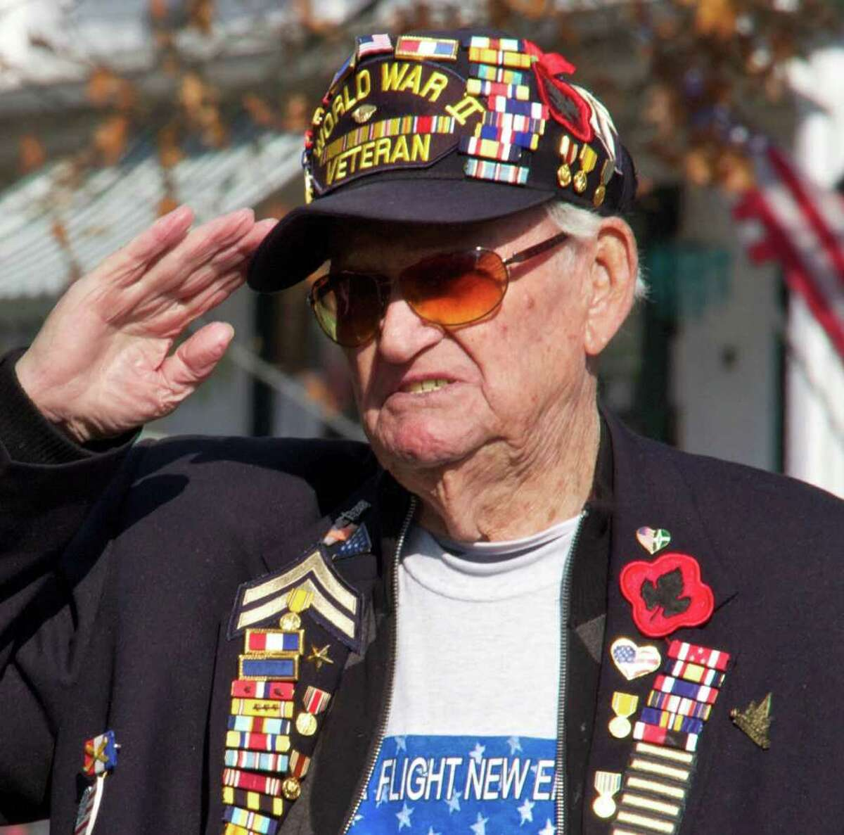 Ed Whaley, a World War II veteran from New Milford, salutes the flag while Curtis Thompson sings the National Anthem at the Veterans Day Ceremony on the New Milford Green on November 11, 2011 at 11:11am.