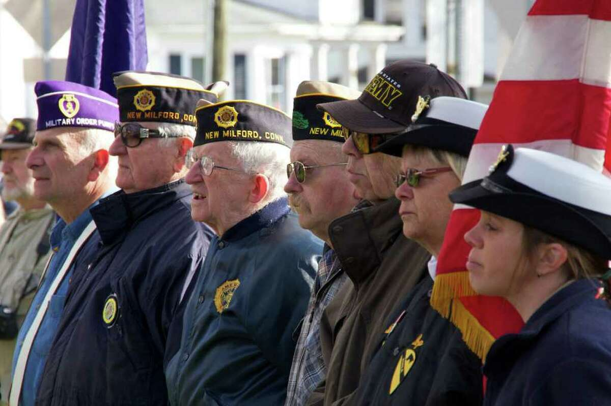 A group of New Milford Veterans listen to Jeffrey B. McBreaitry give a message from the New Milford Veterans Organization at the Veterans Day Ceremony on the New Milford Green Friday, November 11, 2011 at 11:11am.