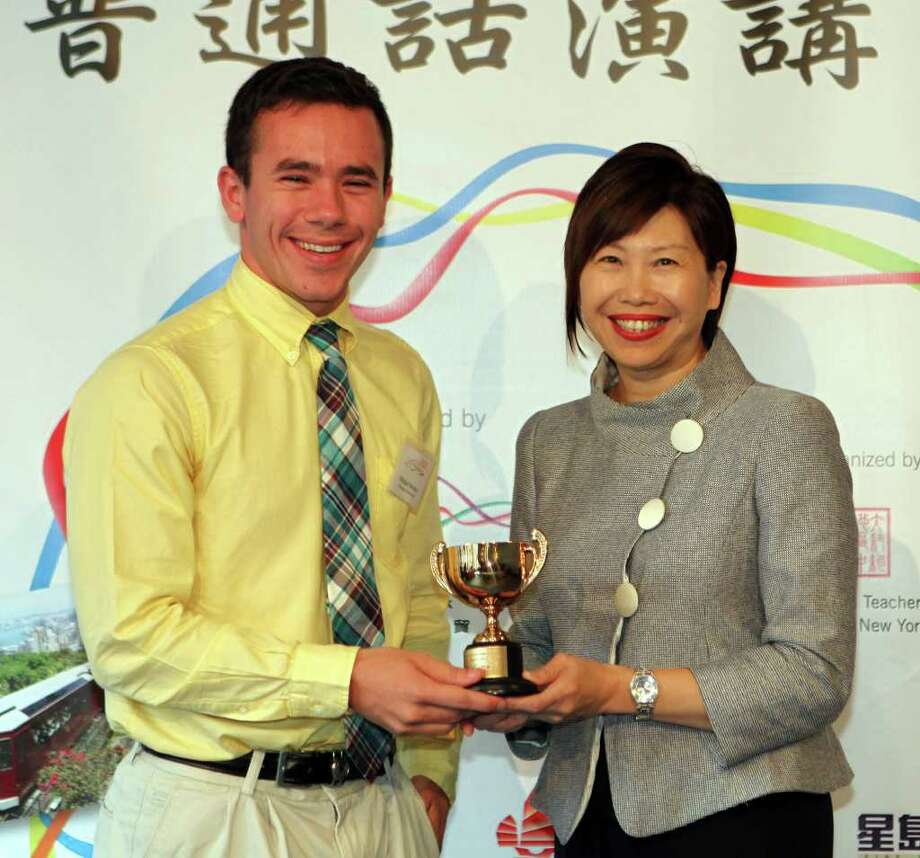19-year-old Michael Becker, a graduate of Brookfield High School, won the top prize in Hong Kong Cup Chinese Speech Contest , a Chinese language competition in New York. He is in picture with Anita Chan, Director of the Hong Kong Economic and Trade Office in New York, which sponsored the contest.  Becker is a sophomore at Princeton University. Photo: Contributed Photo