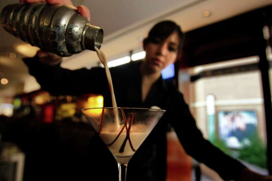 Your average 1.5-ounce liqueur is about 165 calories and is about equal to ... Photo: Johnny Hanson, Houston Chronicle / © 2011 Houston Chronicle