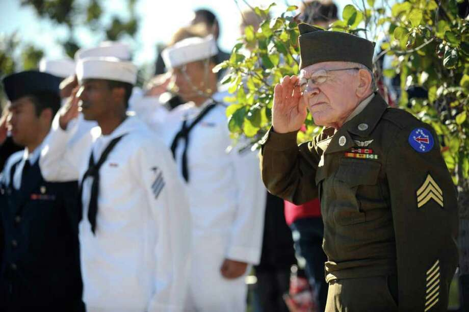 Army veteran James Gerard, who served from 1951-1972, wears his old wool uniform during a Veterans Day ceremony at Fort Sam Houston National Cemetery on Friday, Nov. 11, 2011.  Photo: BILLY CALZADA, SAN ANTONIO EXPRESS-NEWS / gcalzada@express-news.net
