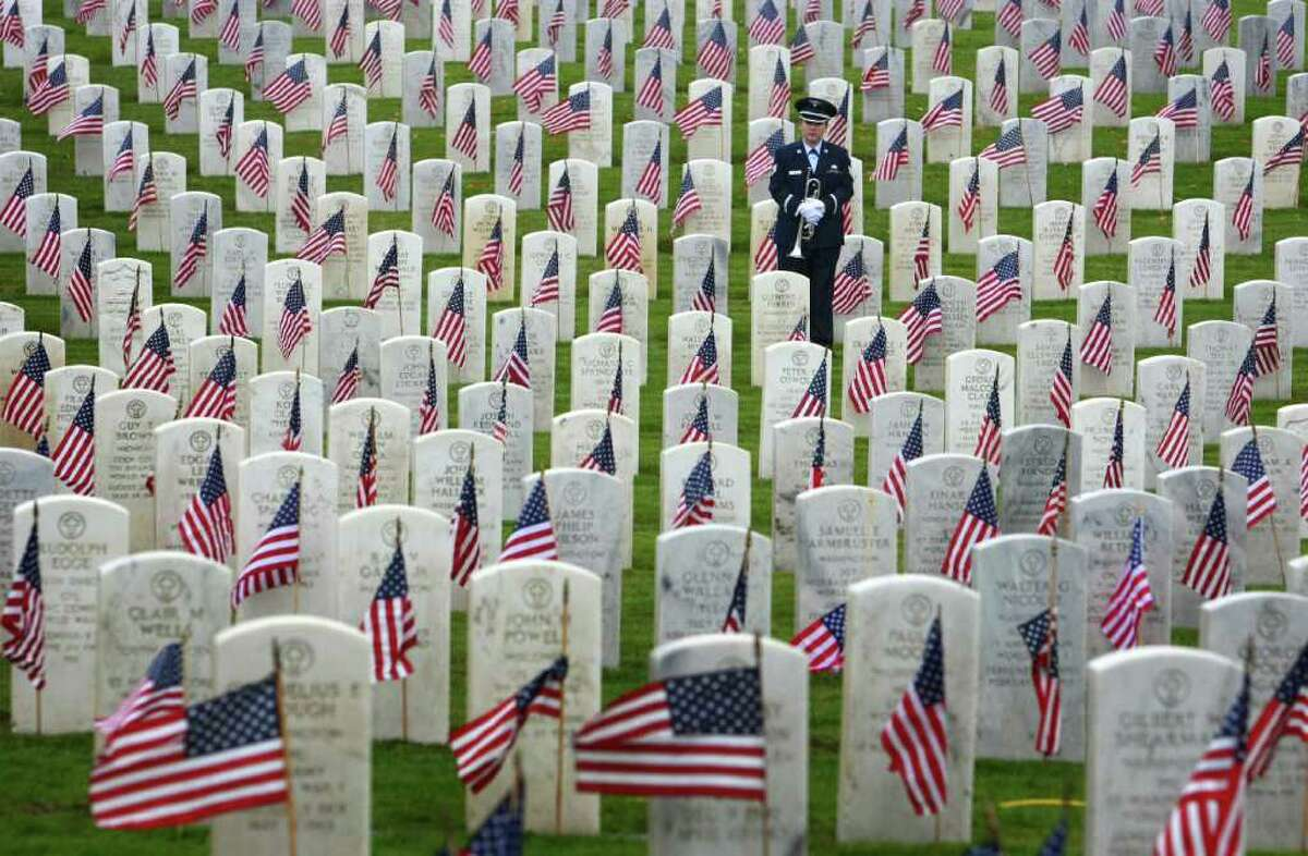 U.S. Air Force Staff Sgt. Dannielle Ritacco stands among headstones during the 62nd Annual Veterans Day Memorial Celebration at Evergreen-Washelli Cemetery in Seattle on Friday, November 11, 2011.