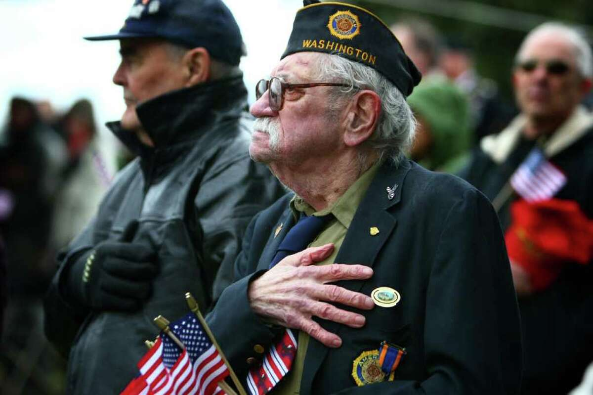 U.S. Navy veteran and American Legion member Walt Gallagher, 88, stands at attention as the Stars and Stripes is presented during the 62nd Annual Veterans Day Memorial Celebration at Evergreen-Washelli Cemetery on Friday, November 11, 2011.