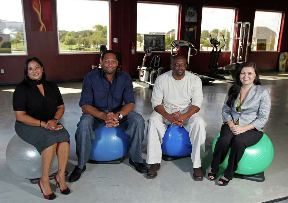 JAMES NIELSEN : CHRONICLE THREE HOUSTON-AREA LOCATIONS: From left, Keva Horry, Robert Horry, Kegis Smith and Anastasia Patoka are business partners in the Robert Horry Center for Sports and Physical Rehabilitation. They are aiming to open locations in Baytown and Katy next year. Photo: James Nielsen / © 2011 Houston Chronicle