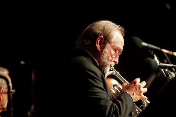 """Local jazz great Jim Cullum, playing his familiar brass cornet, joins the rest of his group, The Jim Cullum Jazz Band, in a performance at the Pearl Stable to celebrate their 20th anniversary of their public radio program """"Riverwalk Jazz"""" on Wednesday, October 7, 2009. They were playing in front of an audience during a taping for the show. Kin Man Hui/kmhui@express-news.net"""