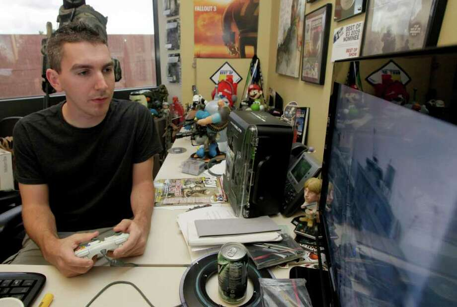 Nick Ut : Associated Press BATTLING ON: Creative strategist Robert Bowling, who has been at Infinity Ward since the first Modern Warfare, believes casual fans don't know - or don't care - about the turmoil. Photo: Nick Ut / AP
