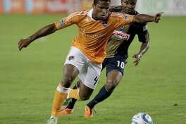 3/19/2011 : Jermaine Taylor , #4 of the Houston Dynamo winds iup for a shot while being chased by Danny Mwanga , #10 of the Philadelphia Union in the second half on Opening Day at Robertson Stadium in Houston, Texas. Union won 1 to 0. Special to the Chron: Thomas B. Shea