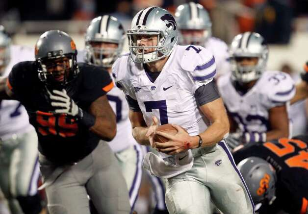 Kansas State quarterback Collin Klein carries against Oklahoma State in the fourth quarter of an NCAA college football game in Stillwater, Okla., Saturday, Nov. 5, 2011. Oklahoma State won 52-45. Photo: AP