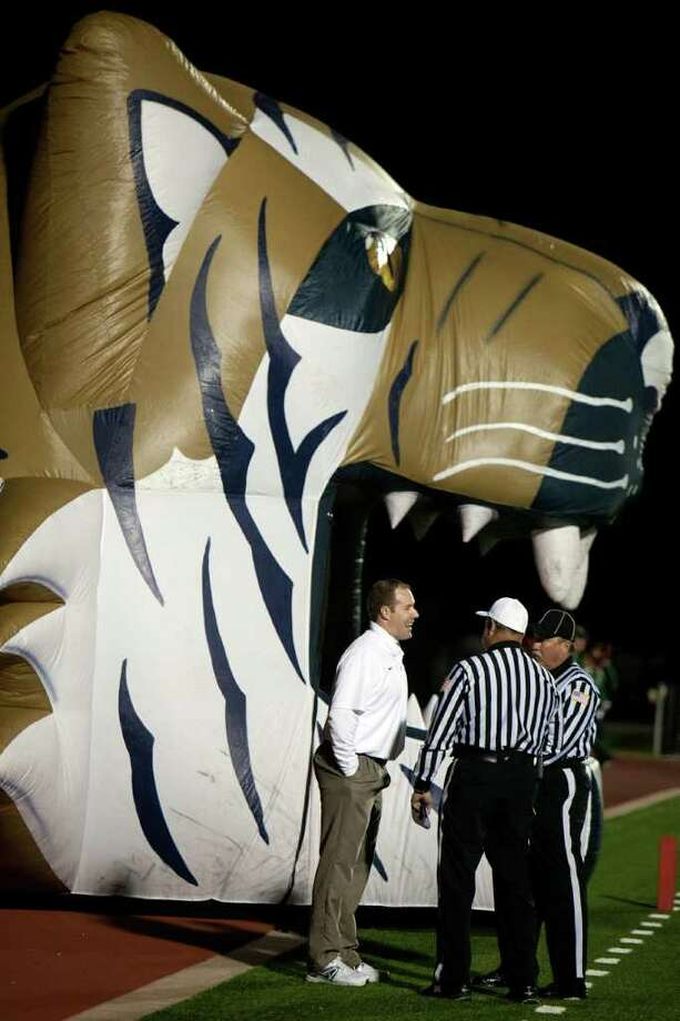 Klein Collins head coach Drew Svoboda chats with officials before facing The Woodlands in a high school football playoff game at Turner Stadium, Friday, Nov. 11, 2011, in Humble. Photo: Smiley N. Pool, Houston Chronicle / © 2011  Houston Chronicle