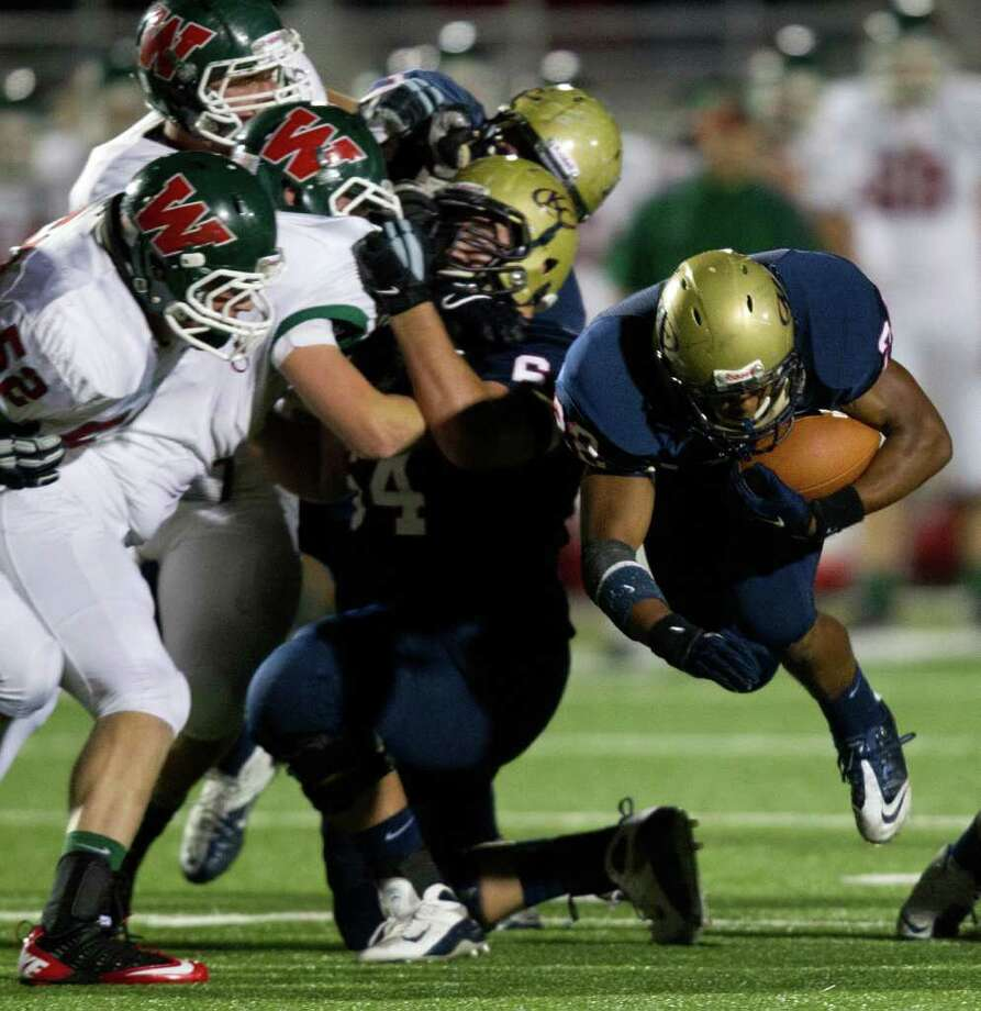 Klein Collins running back Ellison Powell (22) finds a hole in The Woodlands defense during the first quarter of a high school football playoff game at  Turner Stadium, Friday, Nov. 11, 2011, in Humble. Photo: Smiley N. Pool, Houston Chronicle / © 2011  Houston Chronicle