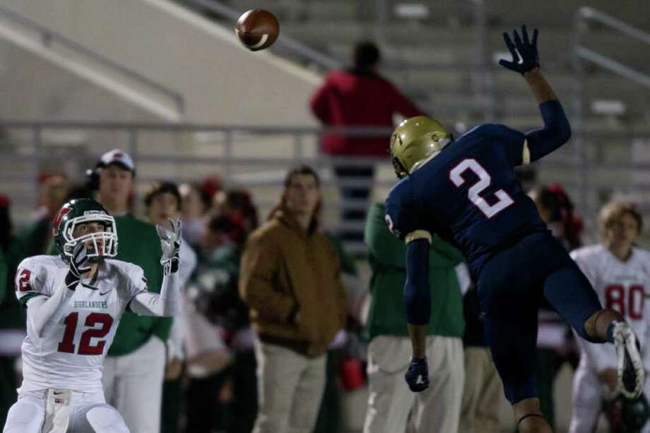 The Woodlands wide receiver Cameron Klapesky (12) makes a catch as Klein Collins defensive back Jordan Thomas (2) defends during the first quarter of a high school football playoff game at  Turner Stadium, Friday, Nov. 11, 2011, in Humble. Photo: Smiley N. Pool, Houston Chronicle / © 2011  Houston Chronicle
