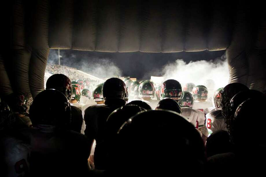 The Woodlands players prepare to take the field against Klein Collins during for a high school football playoff game at Turner Stadium, Friday, Nov. 11, 2011, in Humble. Photo: Smiley N. Pool, Houston Chronicle / © 2011  Houston Chronicle