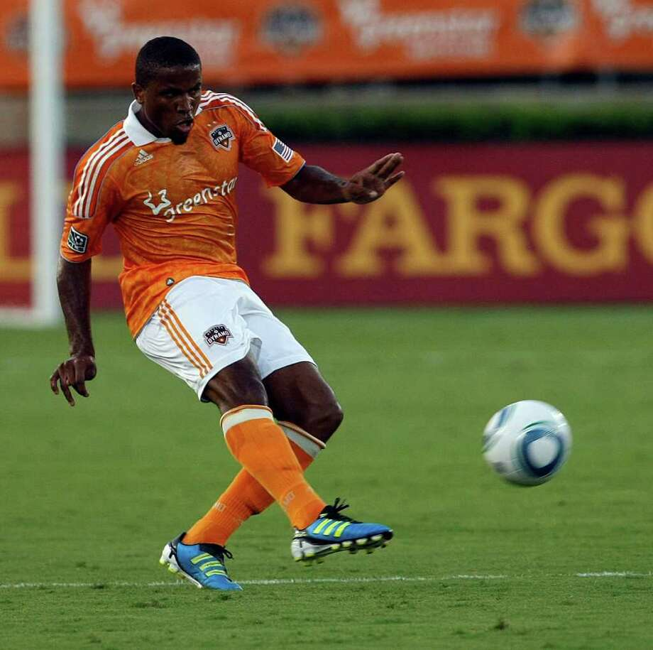 JOHNNY HANSON : CHRONICLE BACK IN THE FOLD: Jermaine Taylor is likely to start the MLS Cup final and concentrate on slowing the Galaxy offense in general and Landon Donovan in particular. Photo: Johnny Hanson / © 2011 Houston Chronicle