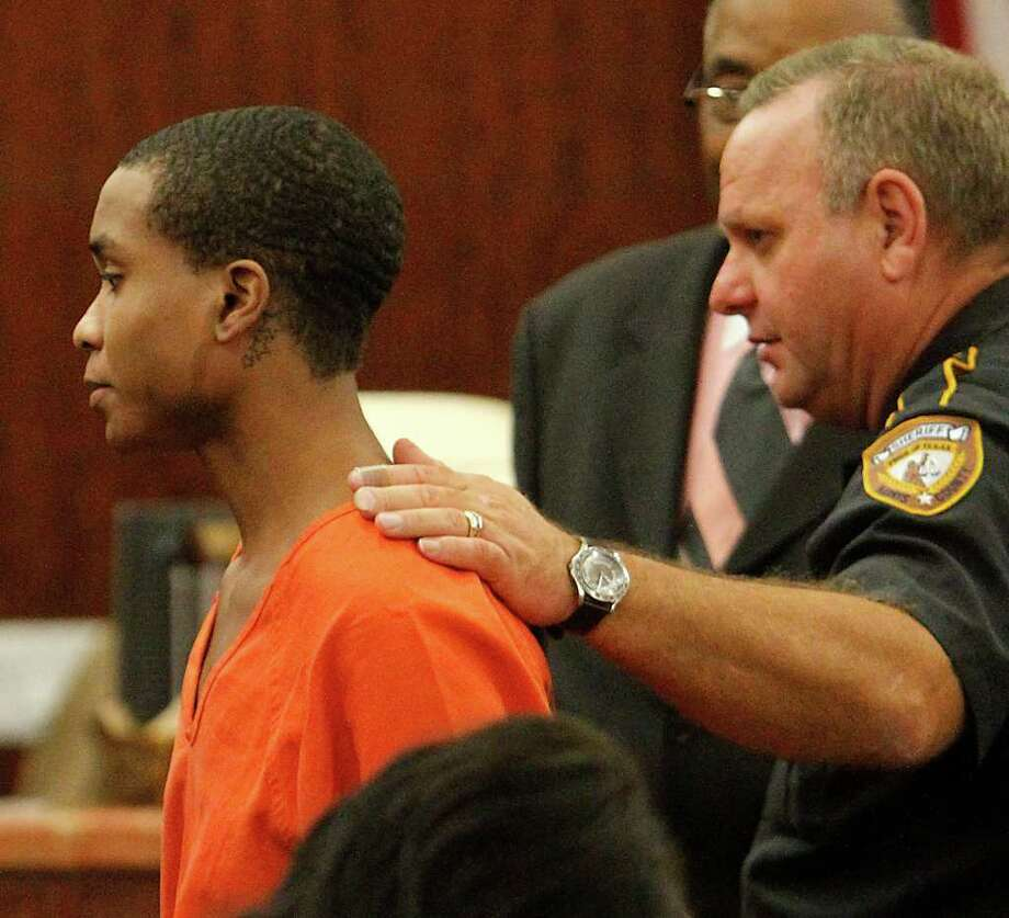 William Fuller, 21, is lead out of a courtroom at the Harris County Criminal Courthouse in October. Photo: Karen Warren / © 2011 Houston Chronicle