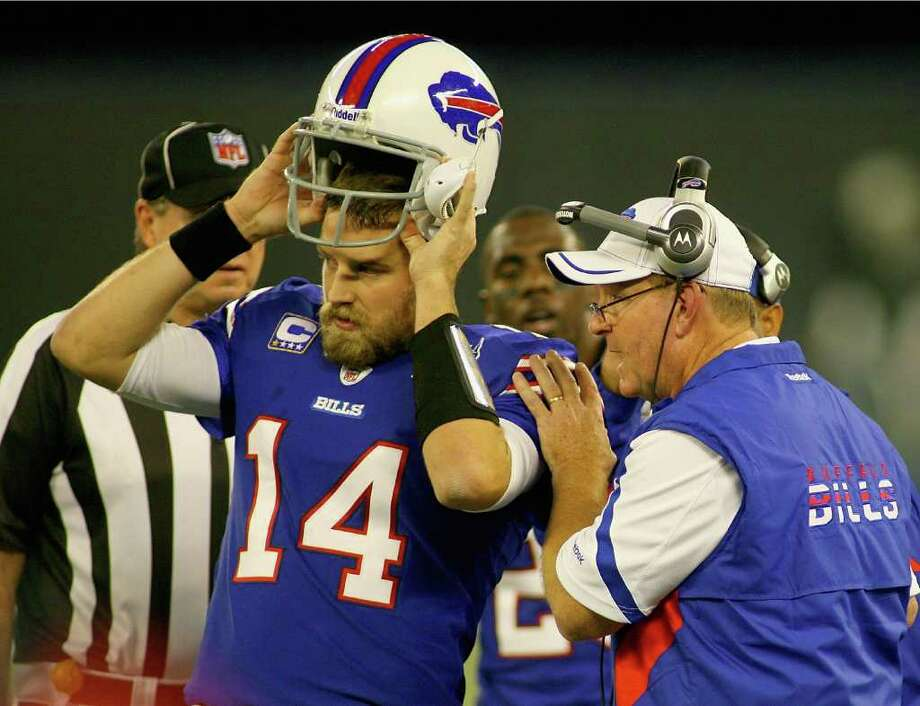 RICK STEWART: GETTY IMAGES MOVED ON: Bills head coach Chan Gailey, right, said he doesn't dwell on the circumstances that led to his firing in Dallas. Photo: Rick Stewart / 2011 Getty Images